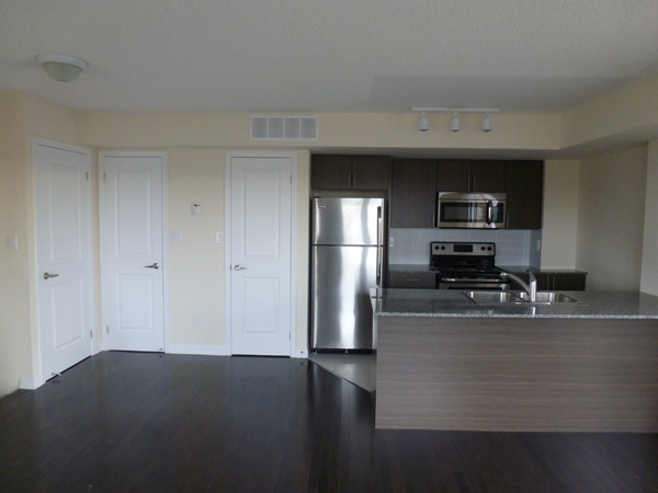 Brand new townhouse for sale in the Junction Triangle. Never lived in.     2 bedrooms plus den, 2 washrooms, 1 underground parking. 1238 Sq Ft plus 200 Sq Ft private terrace - $440000  Royal LePage Real Estate Services Ltd.  Mobile: 647-274-8565