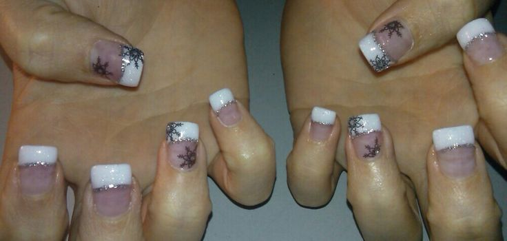 Winter snowflake nails! Pink and white french tip acrylic nails with stamped nail art and free hand nail art under white tips with gel top coat.
