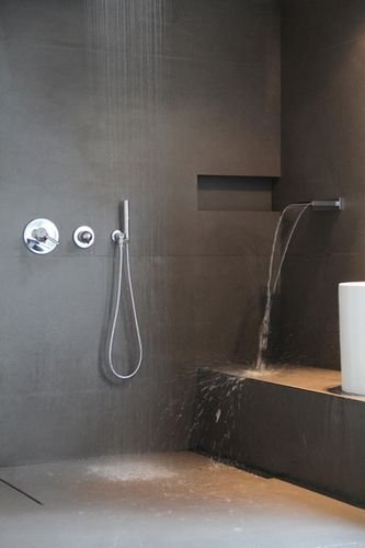 some kind of bench in shower? open shower with rain shower and wall outlet