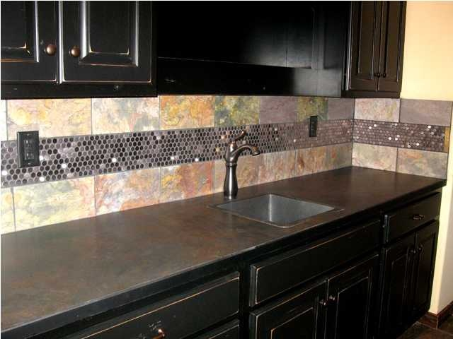 Love this tiling in the downstairs wet bar of 1519 ridgehurst in stonebridge! the did a great job making the metallic go with the colored tiles. we love this idea to add a little spice to a bar!