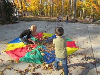 Putting leaves on the parachute (use a sheet if you don't have a parachute)
