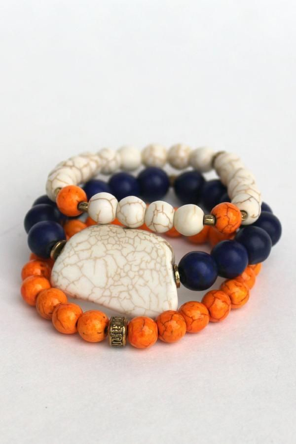These navy, orange, and white beaded stretch bracelets were handmade in Jacksonville, FL. The variegated stone beads of natural labradorite with antique gold accents are great for stacking and feature