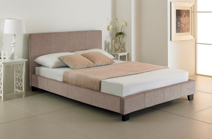 The Valencia is a classic-looking bed frame upholstered in a soft, stone fabric. Features a stylish high headboard and dark wooden feet.