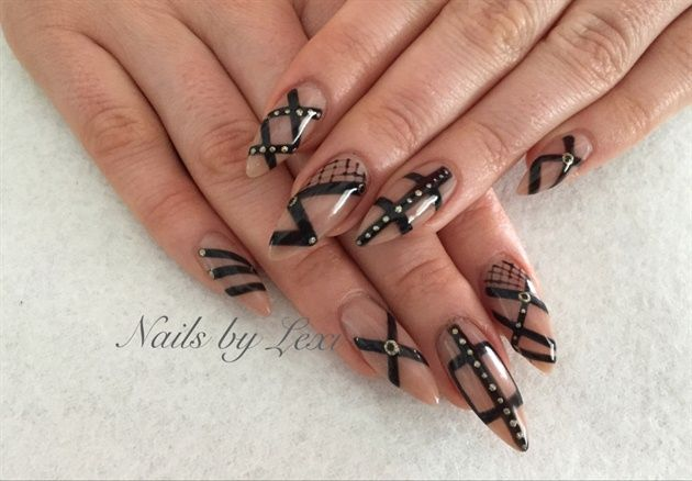 Artistic nail designs rock hard acrylic enhancements with artistic Colour gloss hand painted nail art.  Colour gloss colors used: Cafe latte, Empowered, Swag, Gorgeous.