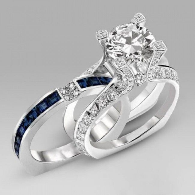 http://www.evolees.com/two-in-one-round-cut-diamond-and-navy-blue-sapphire-engagement-ring-and-wedding-band-bridal-set.html Two-in-one Round Cut Diamond And Navy Blue Sapphire Engagement Ring And Wedding Band Bridal Set