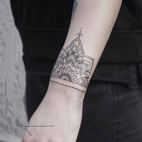 Half mandala on the wrist by Rachainsworth. Tattoo artist:... geometric shape;band;black;of sacred geometry shapes;mandala;rachainsworth;wristband;blackwork;wrist;tatuaje;sacred geometry;tatuajes;medium size;geometric;half mandala