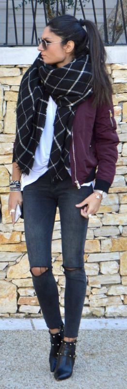 Federica L. shows us how to wear the oversized scarf trend; pairing this checked black scarf with a plain white tee and burgundy bomber. Brands not specified.