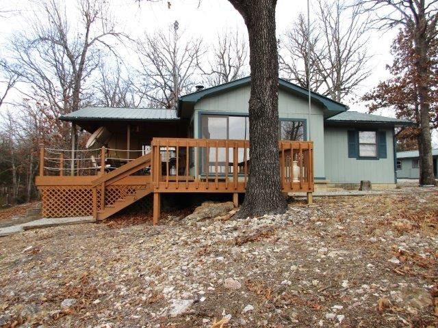 To Bull Shoals Lake we shall go. This 3BR, 2BA Lake home comes with all kitchen appliances, furniture, & 2 slip solar powered dock with boat lift. Property features 2.65 acres m/l with year round lake view, metal roof, wood burning stove, storm cellar, 2 outbuildings (one w/220), carport, and covered back porch. Don't miss out because this one is priced to move in Peel AR