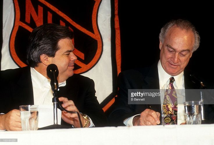 Gil Stein vice-president and legal counsel for the NHL sits with the owner of the Los Angeles Kings and chairman of the NHL Board of Governors Bruce McNall during an event in December, 1992.