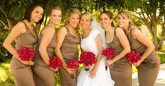 red and tan wedding. taupe colored dresses with red or burgundy bouquets would go with my woodsy wedding theme