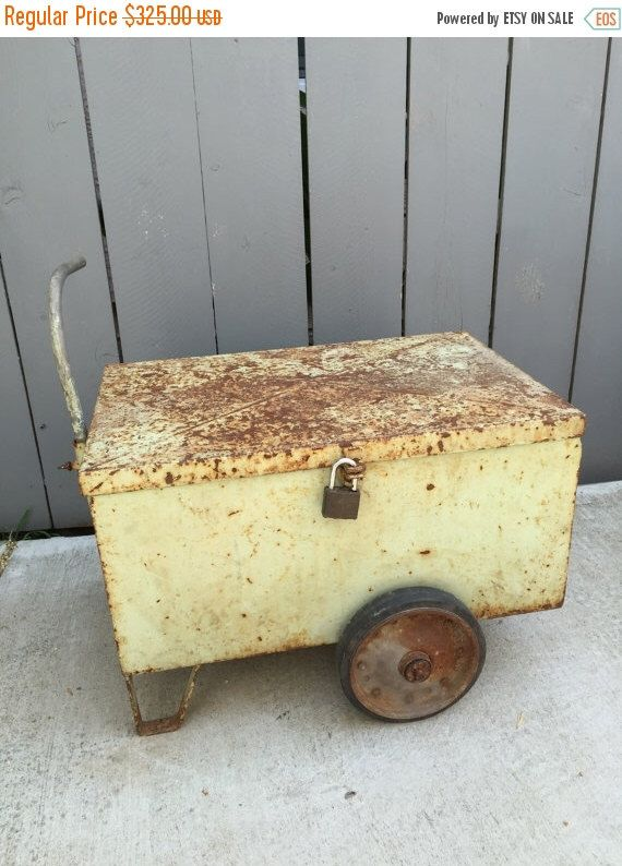 A personal favorite from my Etsy shop https://www.etsy.com/listing/277485118/metal-tool-box-on-wheels-with-pipe
