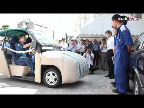 A car with it's airbags on the outside.