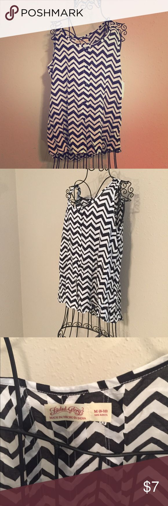 Black and White Chevron Top Your day will be easy breast in this carefree button down sleeveless top. Black and white chevron stripes add fun to your wardrobe. Top is long enough to pair with leggings. Add a cardigan to transition into fall! EUC, Smoke Free Home Faded Glory Tops Tank Tops