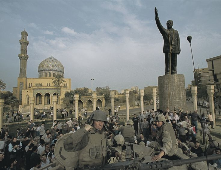 As viewers watched on television, Marine Gunnery Sergeant Leon Lambert and Corporal Edward Chin prepared to bring down the statue of Saddam Hussein in Baghdad's Firdos Square.
