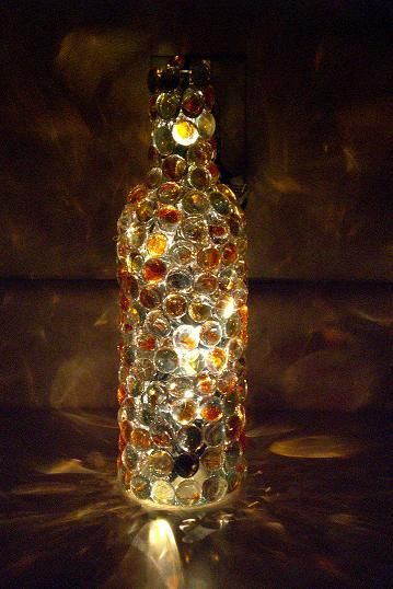 Hot glue marbles or the flat glass stones you can buy at the dollar store to a wine bottle and fill it with lights.: Night Lighting, Decoration Bottle, Glasses Bottle Decoration, Wine Bottle Lamps, Flats Marbles, Bottle Lighting, Empty Wine Bottle, Christmas Lighting, Mosaics Wine