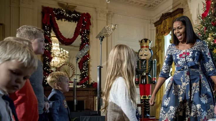 First lady Michelle Obama, right, greets children of military families in the East Room of the White House during a preview of the 2016 holiday decor, Tuesday, Nov. 29, 2016, in Washington. (AP Photo/Andrew Harnik)