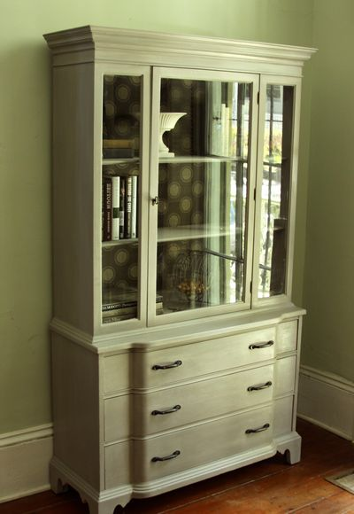 I LOVE this china cabinet makeover.  i wish i could find a great piece to redo.  not sure about using milk paint though.