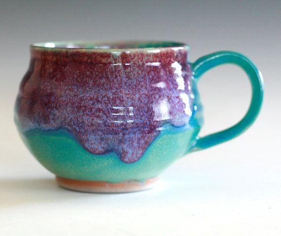 "3.5"" tall, 3.5"" opening, holds 18 oz This mug is wheel thrown and high fired. Glazed in turquoise/purple. All of my glazes are high fired, food, dishwasher and microwave safe."