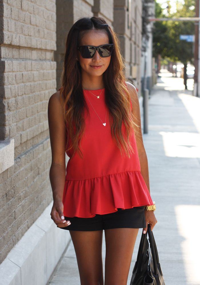 Casual red peplum top, black shorts, black tote, and oversized black sunglasses.