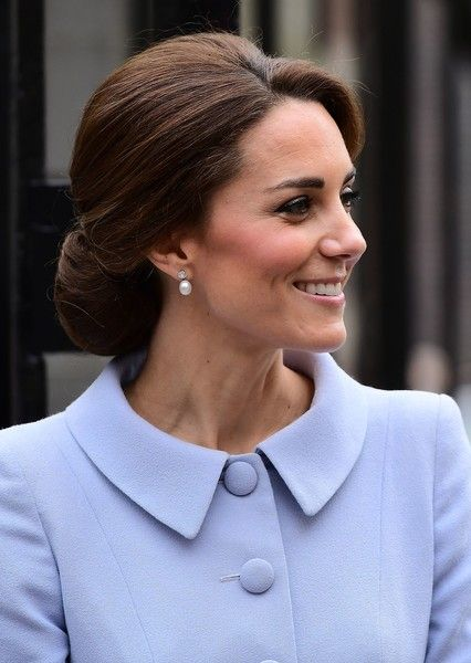 "Britain's Catherine, Duchess of Cambridge leaves after visiting the exhibition ""Vermeer and Contemporaries from the British Royal Collection"" at The Mauritshuis art museum - home to the best of Dutch Golden Age painting, in The Hague, the Netherlands, on October 11, 2016.  .Britain's Catherine, Duchess of Cambridge is on her first official foreign solo visit. / AFP / EMMANUEL DUNAND"