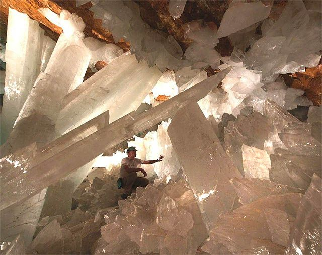 Mexico: Giant Selenite Crystals!    In 2000, one of the most unusual and splendid caves was found in Mexico by miners. Located only a mile from an upthrust of magma, this cave is 112 degrees Farenheit and at 90-100% humidity, limiting greatly the amount of time explorers can spend in it. It is a spectacular cave, with gigantic crystal formations thought to be 600,000 years old.