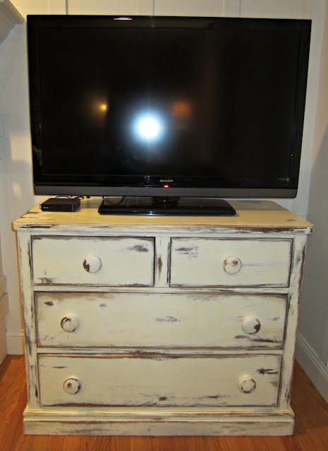 How to distress a garage sale dresser.  I would have left the top drawers out and made a space for my DVR and DVD.