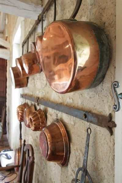 I am soon bringing home my mother's lovely old copper pans that look like these. Am busy making a place of honor for them!