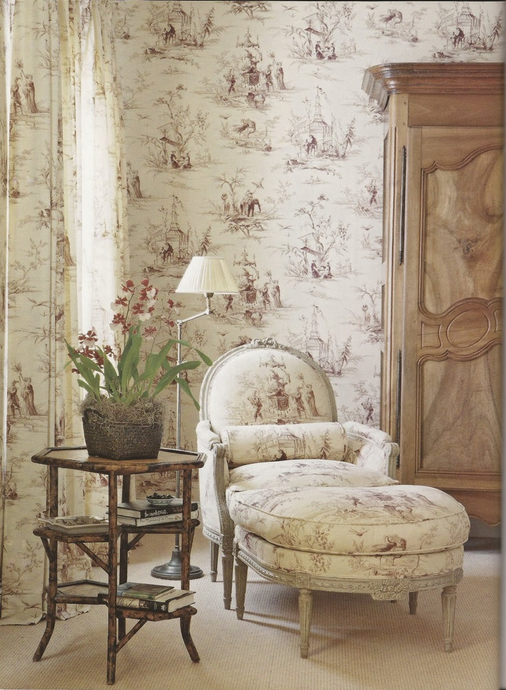 French Country, Belclaire House. Serene corner in taupe and ivory living room, French chair, toile wallpaper, natural wood armoire.