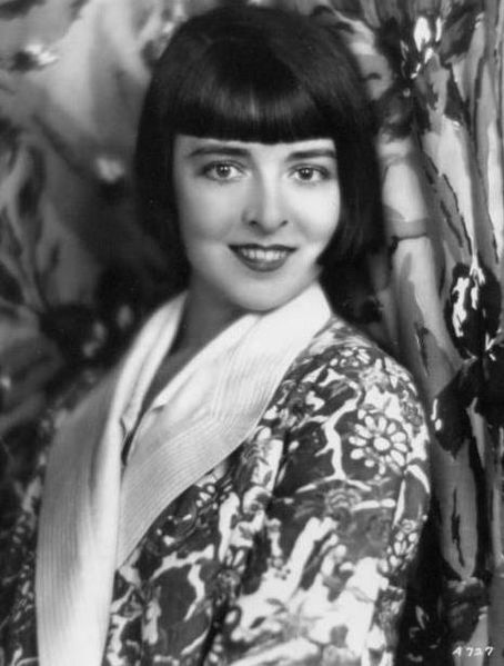 Promotional portrait of actress Colleen Moore at the height of her fame, c. 1927, showing the famous Dutchboy bobbed haircut that she helped make famous.