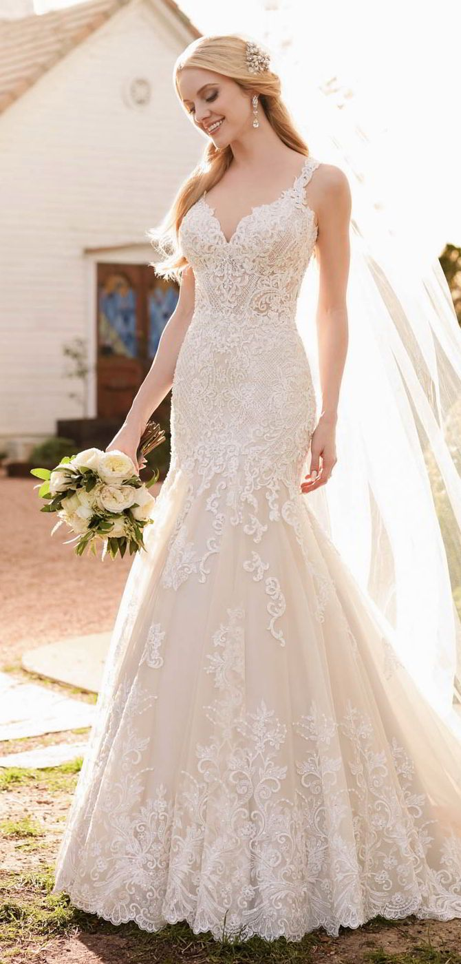 Drawing inspiration from romantic styles of the past, this vintage wedding dress from Martina Liana has been updated for today's fashion-forward bride. Exuding a luxe, rich feeling, lattice detailing pairs with lace and tulle over Dolce satin gown to create a unique style. In a trumpet silhouette, the lace-adorned skirt of this wedding dress is not only breathtakingly beautiful, it also draws the eye up, creating an hourglass silhouette and showcasing your curves exceptionally. The back of…
