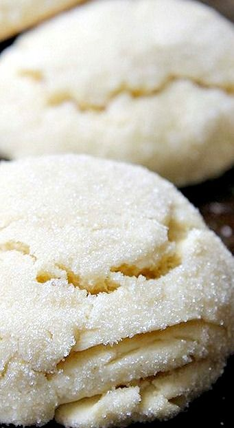 Lemon Pillow Cookies Recipe ~ The texture of these is somewhat light with a crisp exterior thats crusted in sugar. Sort of like a scone crossed with a cookie. Called pillow cookies because of their fluffy, pillow-like look thanks to baking powder, an ingredient not often found in cookie dough. The lemon flavor is light, just enough to make the cookies a little extra special.