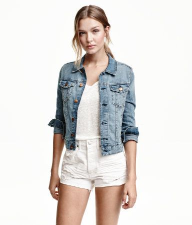 Denim blue. Jacket in washed stretch denim with distressed details. Chest pockets with flap and button, concealed side pockets at front, and adjustable tab