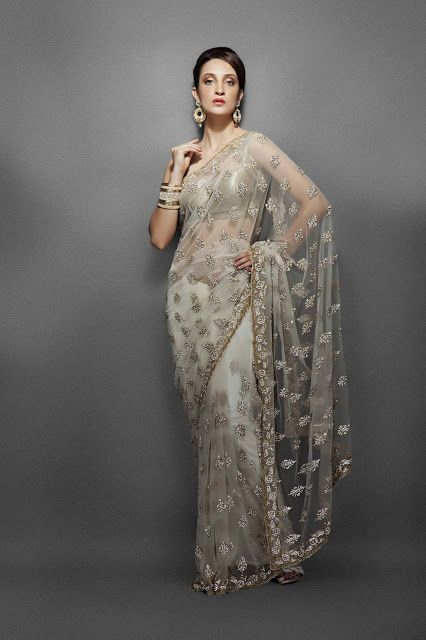 Z Fashion Trend: IVORY NET SAREE WITH SLEEVELESS BLOUSE
