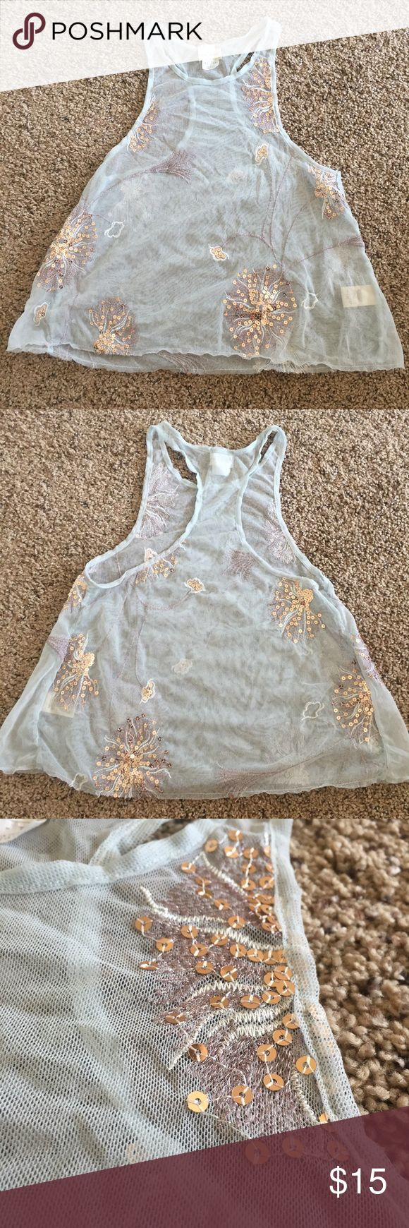 Free People sequined sheer crop top Light blue mesh sequined crop top by free people (intimately). Cute for layering! Hits right at my belly button. Free People Tops Crop Tops