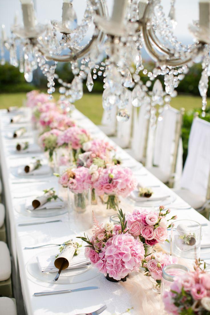 Guest Tables under sparkled chandelier