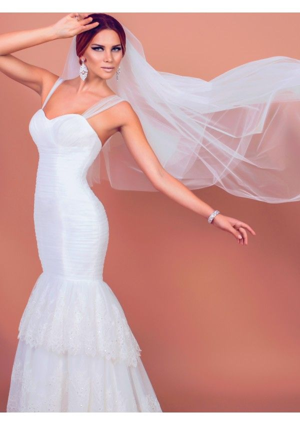 Choose the Alyssa wedding gown if you want to feel like a goddess. Alyssa is made of precious tulle, taffeta and ivory embroidery. You will be both sensuous and seductive on your most special day.