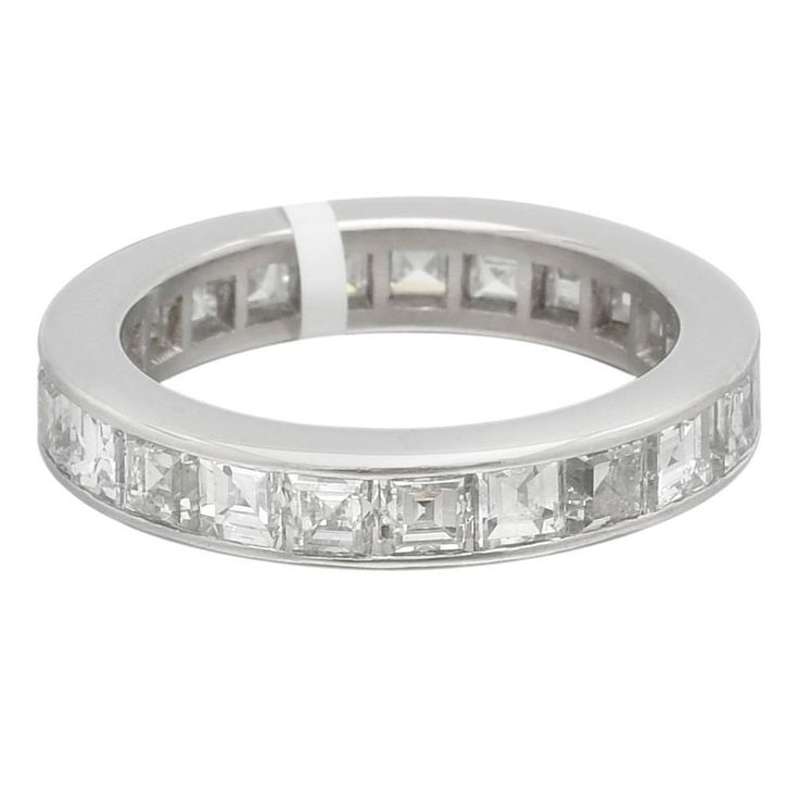 Square-Cut Diamond platinum Eternity Band ring | From a unique collection of vintage wedding rings at https://www.1stdibs.com/jewelry/rings/wedding-rings/