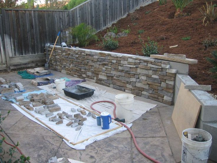 Cover ugly concrete block walls with stone basement - How to cover exterior cinder block walls ...