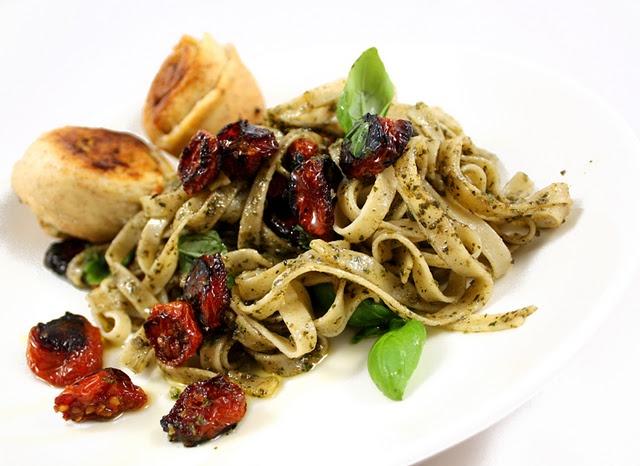 Vegan friendly baked tomatoes and homemade pesto pasta.
