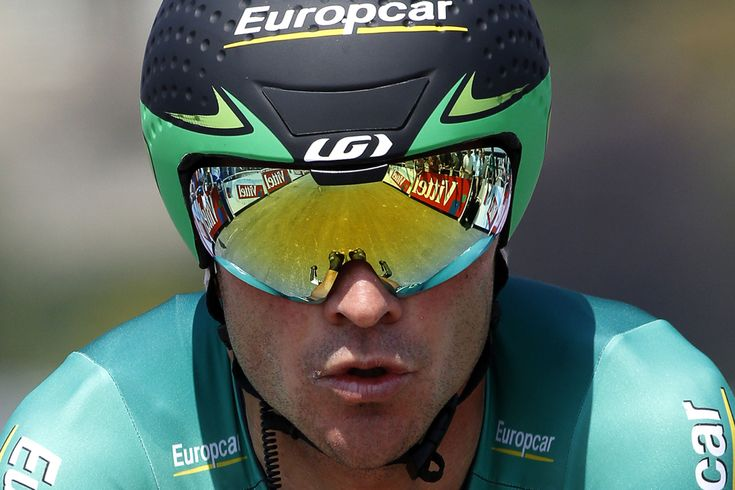 France's Thomas Voeckler is about to cross the finish line at the end of the 33 km individual time-trial and eleventh stage of the 100th edition of the Tour de France cycling race on July 10 between Avranches and Mont-Saint-Michel, northwestern France. (Pascal Guyot/AFP/Getty Images) - See more at: http://www.boston.com/bigpicture/2013/07/tour_de_france_100th_edition_p_1.html#sthash.Lx9uVNEJ.dpuf