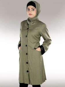 A-line Tunic. Front open, fabric button closure. Utility pockets both sides in front. Circular design sequin embroidered lace at sleeve hems. Matching Square hijab and Band can be bought Separately