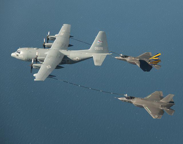 Marine KC-130 Harvest Hawk refueling a pair of F-35C Lighting II