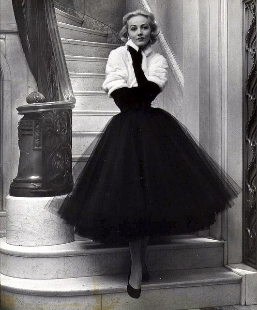 1951 ~ White shawl-collared ermine bolero by Maximilian shows off the wearer's waist and emphasizes her bouffant skirt of short ball gown by Traina-Norell, photo by Nina Leen