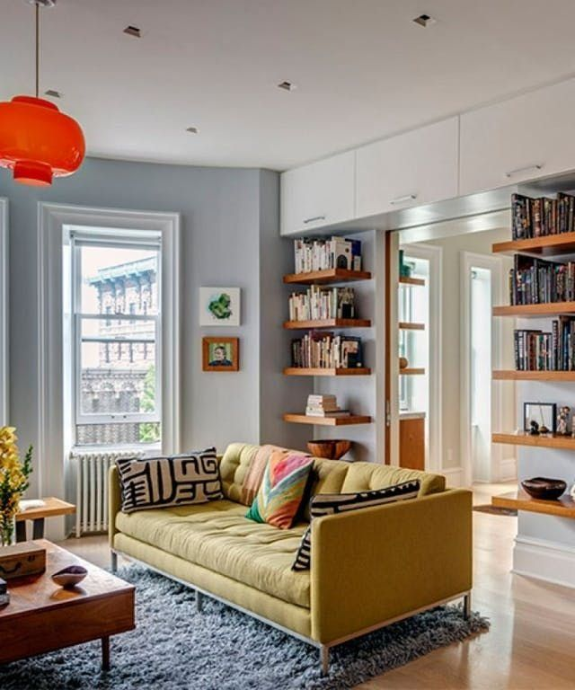 Those over-the-door storage cabinets! And love the yellow sofa and red lamp. living room