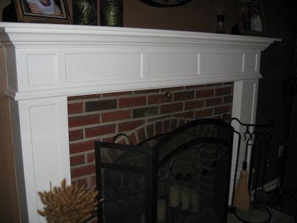 Mantle around brick fireplace