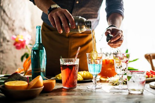 Stock Photo  Bartender guy working prepare cocktail skills - bartender skills