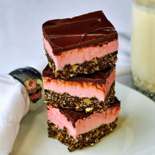 Raspberry Nanaimo Bars - a popular no-bake recipe with a flavor twist on the classic Canadian cookie bar treat. Perfect for the holiday freezer.