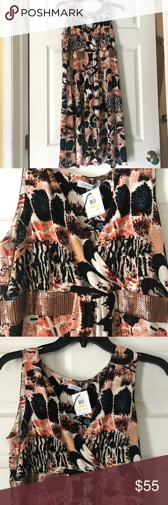 Calvin Klein size medium womens empire waist dress Calvin Klein size medium empire waist dress with sequins floral pattern. New with tags attached. Soft silky  fabric Calvin Klein Dresses Midi