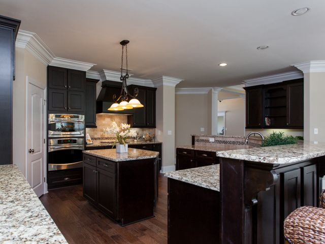 Deep espresso cabinets with light granite countertops new for Model kitchens with white cabinets
