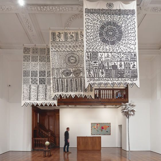 Rachid Koraïchi's tapestries hang from the ceiling, telling the stories of the…